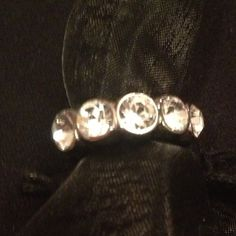 Sterling Silver Ring  NWT NWT Sparkle Sparkle Size 5 graduating faux diamonds SS Ring looks expensive! Thick bandwidth with Designer  signature Very pretty pinky ring. DYRBERG  Jewelry Rings
