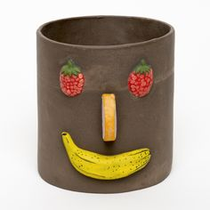 """This pot is cast in a dark brown clay and is hand painted with colorfast  matte glazes.  Dimensions: 8"""" x 8""""  Made in our studio in Brooklyn, NY.  Please allow 2 weeks for delivery."""