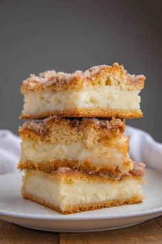Sopapilla Cheesecake Bars are a quick and easy cheesecake dessert recipe with just six ingredients you can make in less than an hour that taste like a churro cheesecake! #cheesecake #sopapilla #mexicanfood #mexicandesserts #churro #dessert #dinnerthendessert