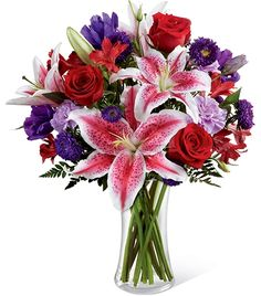 The Stunning Beauty Bouquet is an absolutely lovely way to send your love and affection across the miles. Fragrant Stargazer lilies stretch their star-like petals across a bed of rich red roses, lavender carnations, red Peruvian lilies, purple double lisianthus, purple matsumoto asters and lush greens.  #ValentinesDay2015 #ValentinesDay #ValentinesDay2015Flowers #ValentinesDayBouquets Click On the Image to Get IT