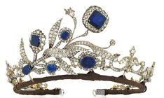 1890 sapphire and diamond tiara assembled from an earlier brooch and a later, formerly the property of a Gentleman of Title. A fleur de lys tiara necklace, which has had the front portion of it removed and the earlier sapphire and diamond brooch put in place. It sold at Christie's in late 2014, for £74,500.