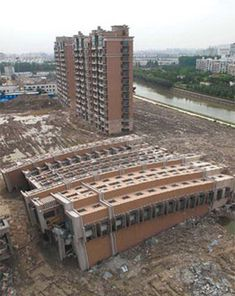 A nearly finished, newly constructed building in Shanghai toppled over. The cause of this epic structural fail is under investigation, but first sources claim that an error on construction and unstable soil conditions are the probable causes.