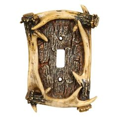 "The resin faux Antler Single Switch Plate completes your rustic rooms. Hardware included. Measures 4""W x 1""D x 6""H. ~"
