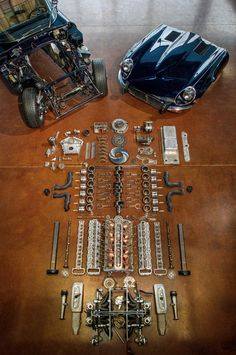 Jaguar E-Type deconstructed. My favorite car. I like it more assembled, but even the parts are gorgeous (what a lovely engine).