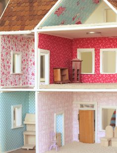 We got a 65-year old wooden dollhouse from Freecycle. Now to the inspiration to modge podge with fabric & paper.