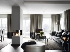 The perfect fireplace; one that can be enjoyed from both the living room and the dining room.