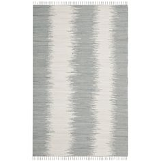 The soft cotton surface of this gray handwoven rug makes it the perfect choice for any room where you want to kick your shoes off and relax. The contemporary styling, complete with a minimalist edge fringe, blends well with most modern decor.