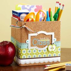 Teacher Survival Kit  Transform a box or basket into a school-year survival kit by decorating it with scrapbooking supplies. Self-adhesive cork paper, patterned paper, and embellishments emphasize the school theme. Fill the kit with essentials for a teacher.