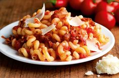 My family loves the Cavatappi Amatriciana at Carrabba's. I tried to find the recipe and failed, so I decided to try for myself. It's soo...