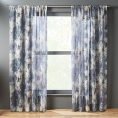 Shop issimo blue curtain panel.   Monet meets tie-dye––Issimo marries a painterly effect with an unscripted pattern and sunwashed palette.  Gauzy/linen-like polyester filters and softens light in muted tones of blue and natural.