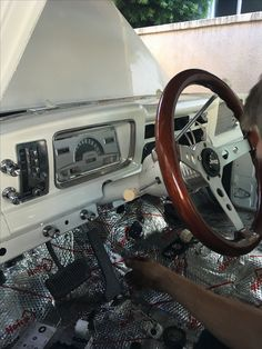 1972 Jeep Wagoneer dash gauges being installed