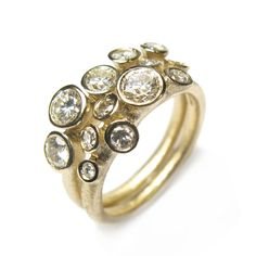 Diana Porter - We love reworking old jewellery into contemporary designs. This showstopper pair of rings is set with the customers own diamonds and made using the customers own gold.