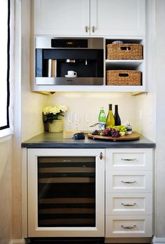 Small, but efficient space. Would add a sink, and glass doors on top cupboards. maybe a wine rack in place of baskets, and tall cupboard instead of drawers.