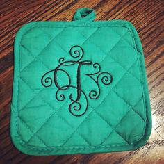 Initial potholder $5. Available with kitchen towel set $10
