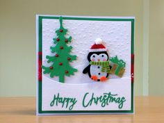 Christmas Card, Handmade - Penguin embellishment with Marianne tree die. For more of my cards please visit CraftyCardStudio on Etsy.com.