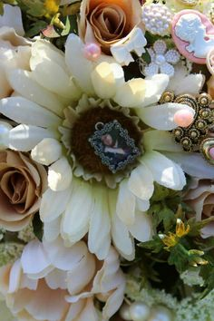 In the center of all of my bridesmaids bouquets and on my groom mother of bride and groom  and father was a small photo of a loved one who passed on. A memory that will be there on your special day.