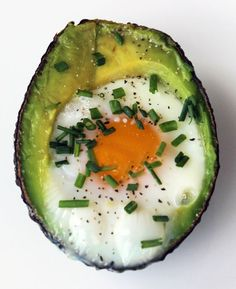 PALEO AVOCADO EGG  1.Preheat oven to 425 degrees  2.Slice avocado in half  3.Take out the pit.  4.Scoop out about 1-2 Tbsp of flesh ( enough for the egg to fit)  5.Crack an egg into each avocado  6.Bake for 15-20 min  7.Remove from oven and season with pepper and chives.