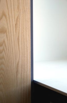 Ash wood and a seamless white HI-MACS kitchen top inside this house renovation in Rotterdam Carnisse by NOMAA|architectuur & interieur #Details