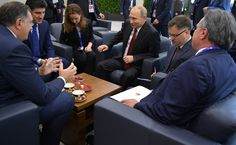 With President of the Republika Srpska, an entity in Bosnia and Herzegovina, Milorad Dodik, Prime Minister of Iraqi Kurdistan Nechirvan Barzani and IAEA Director General Yukiya Amano.