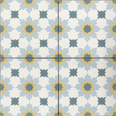 Blue, turquoise and yellow encaustic cement tiles. Handmade, ideally suite to kitchens, hallways and commercial projects.