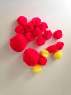 "Packet of 15 Pom Poms. Two 2"" Red Pom Poms. Three 1"" Yellow Pom Poms. Ten 1"" Red Pom Poms. Great for  Noses Flower Centers Trim Fun! by RowesFlyingNeedles"