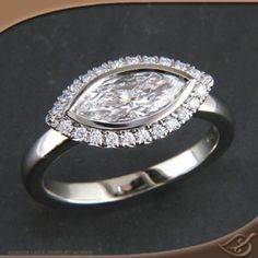 Marquise halo engagement ring. I love oval and marquise cuts set horizontally!