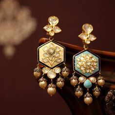 With necklaces and earrings flipping into a new colour combination with the flick of the flinger, Sunita Shekhawat @sunita_shekhawat_jaipur has made #ReversibleJewellery a talk of the town. Showcased here is a white and blue enamel reversible pair of earrings with pearl drops as displayed at the @vogueindia #VogueWeddingShow Photo credit: @preeta_agarwal for #katerinaperezcom