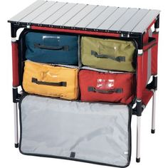 cabela's camp sherpa. one of the four nylon bags is lined for a sink or cooler.....