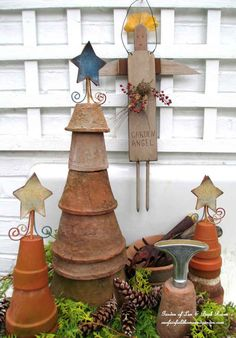 6. Create a seasonal display with upside down clay pots | 17 Charming Garden Art DIYs