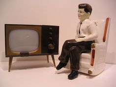 Mam-maw had an old glass china cabinet literally filled with her salt and pepper shaker collection. One of our favorites was the the little t.v. set just like this one. She didn't have the JFK in his rocker.