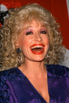 Dolly Parton laughing and smiling big