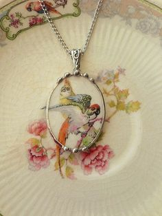 Parrots Broken china jewelry pendant by dishfunctionldesigns