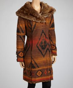 Give chilly breezes the cold shoulder in stand-out style with this chic jacket. Boasting a trendy tribal print with flirty faux fur trim, this lovely layer is a fashionable finishing touch.
