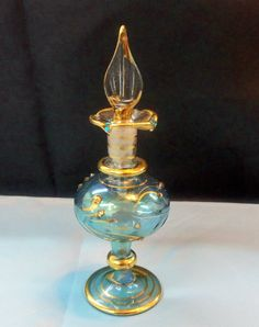 Vintage Egyptian perfume bottle etched in gold and decorated with Swarovski crystals by Krazy4Crystals, please check out our stores at http://www.etsy.com/shop/YOUniqueDZigns and http://www.etsy.com/shop/Krazy4Crystals, $51.00