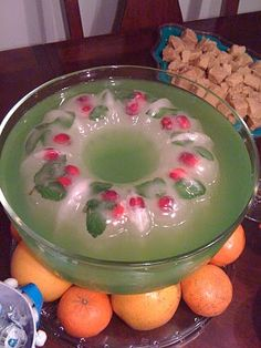 Cool Christmas punch.  Freeze cranberries, mint sprigs, and water in bottom of Bundt cake pan to make a wreath and place in punchbowl.
