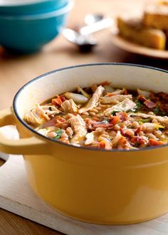 White Bean and Chicken Chili Recipe (This chicken chili recipe draws its crowd-pleasing flavor from bacon, chili peppers, cumin, and cilantro.)