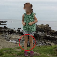 This guy took a picture of his daughter in Japan. The circled part behind her shows a pair of combat boots, yet no one is actually there.