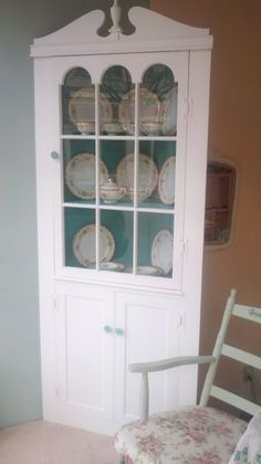 Corner Cabinet In White And Turquoise.
