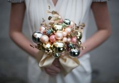 Make a DIY Ornament Bouquet.  Alternative to the traditional floral wedding bouquet  Take advantage of the holiday season and create your own bouquet with glass holiday bulbs!  It's a great nod to the time of year while making a fun (yet elegant) statement.