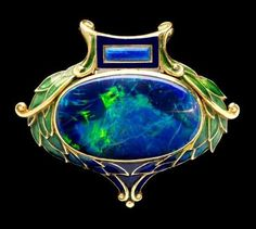 Art Nouveau brooch in enamelled gold set with opal, Marcus & Co. (New York)… by madeleine #VintageJewelry #GoldJewelleryArtNouveau