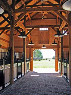 Timber Frame Horse Barn - Something along these lines for my dream barn.  Must have a high ceiling with big beautiful beams.