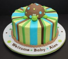 """Turtle Baby  Shower Cake - Turtle Cake for a baby shower. I love how the turtle turned out...he's one of my favorite figures! It's an 8"""" cake frosted in buttercream. Decorations are fondant. Turtle is made from krispy cereal and then covered in fondant. Not sure where the original design came from. The party planners sent me the picture of the cake they wanted, so if you recognize the design, please let me know!"""