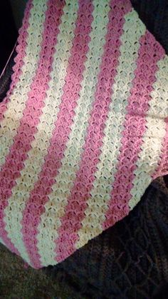 This is a C2C, corner to corner crochet. It is not quite half done. I am doing it in chunky yarn.