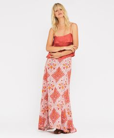 Sabine Wrap Maxi Skirt    Feminine maxi wrap skirt in our large-scale floral print inspired by traditional Norwegian folk art. Maxi skirt has a beautiful train/trail at back hem and side button closure. Looks beautiful styled back with our Sabine cami.