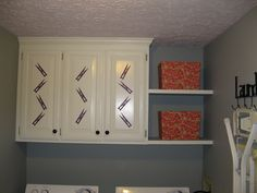 install white cabinets all the way to the ceiling with floating shelves to fill the gap, small laundry room redo