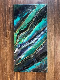 This year, I discovered abstract painting using fluid acrylics. I love the organic feel of this medium and the way it makes images that looks like things in nature. This one looks like layers of marble or limestone to me. It has genuine copper leaf to add flash and dimension. This is an