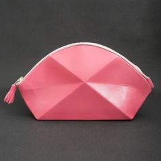 Pyramide Cosmetic Bag Pink  Lara Kazis is fascinated with redefined details. Her latest line is uniquely shaped and constructed from the best European leather.