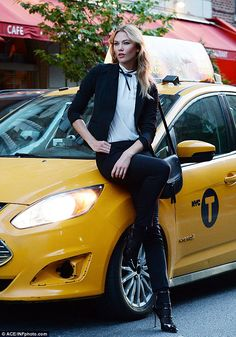 Showstopper: Karlie perched herself atop a New York taxi cab in the middle of traffic for her sexy photo shoot