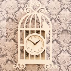 White - Bird Cage Clock | At Home Shopping. This lovely birdcage themed clock is really unusual, and has a vintage feel to it. It can be hung on the wall or even just leant up somewhere. A perfect gift for young and old alike. £13