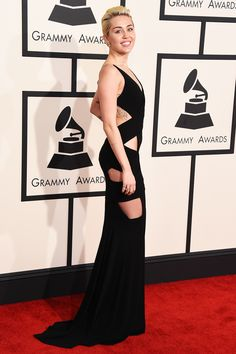 Grammy Looks That Really Went For It #refinery29  http://www.refinery29.com/2015/02/81974/grammys-2015-best-dressed-red-carpet-photos#slide-19  Miley Cyrus oscillates between '90s slip-dress minimalism and S&M art project, and this Alex Vauthier dress is half-and-half from each of her worlds.